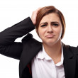 Unhappy businesswoman with hands on head — Stock Photo #36215475