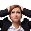 Unhappy businesswoman with hands on head — Stock Photo