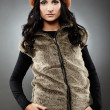 Woman wearing fur vest and cap  — Stock Photo