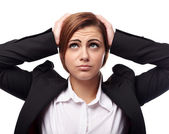 Unhappy businesswoman with hands on head — Stockfoto