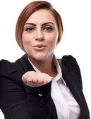 Attractive businesswoman blowing kisses — Stock Photo