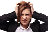 Angry businesswoman pulling off her hair — Stock Photo