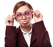 Woman wearing nerg glasses and making funny faces — Stock Photo