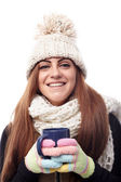 Young beautiful woman wearing cap, scarf and gloves and holding — Stok fotoğraf