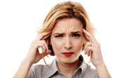 Businesswoman having a headache — Stock Photo