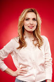 Cheerful blonde wearing shirt with hand on hip — Stock Photo