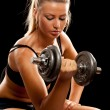 Young woman doing workout — Stock Photo