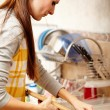 Housewife in the kitchen cleaning the wooden board — Stock Photo