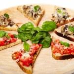 Freshly cooked tomato and mushroom bruschettas — Stock Photo #36966899