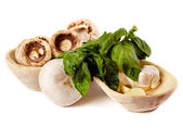 Fresh champignons, garlic and basil in wooden bowsl — Stock Photo