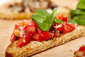 Tomato and mushroom bruschettas — Stock Photo