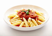 Traditional italian pasta with tomato sauce and basil — Stock Photo