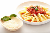 Traditional italian pasta with tomato and peperoni sauce — Stock Photo