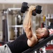 Stock Photo: Athletic man working his chest