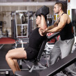 Personal trainer helping athletic man — Stock Photo #37799595