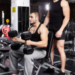 Personal trainer helping athletic man — Stock Photo