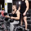 Stock Photo: Personal trainer helping athletic man