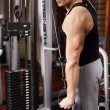 Athletic man pulling heavy weights — Stock Photo #37799875