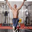 Athletic man doing hanging legs raise — Stock Photo