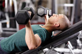 Athletic man working his chest — Stock Photo