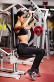 Sexy young woman training at the gym — Stock Photo