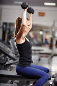 Athletic woman working with dumbbells — Stock Photo