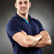 Handsome young man with arms folded — Stock Photo
