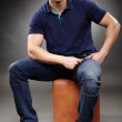 Handsome young man sitting down — Stock Photo #38045031