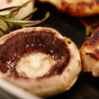 Fried pork chops and champignon mushrooms in the frying pan — ストック写真