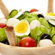 Fresh salad in a wooden bowl — Stock Photo #38045749