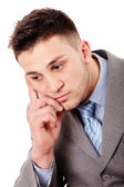 Pensive businessman with hand on chin — Stock Photo