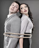 Couple tied with a rope — Stock Photo