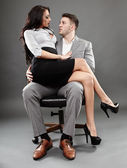 Secretary sitting on the boss lap — Stock fotografie