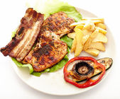 Pork steak, potatoes and vegetables — Stock Photo
