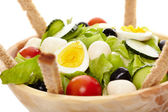 Fresh salad in a wooden bowl — Stock Photo