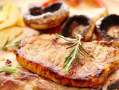 Fried tenderloin and grilled mushrooms — Stock Photo