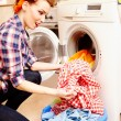 Housewife putting laundry into washing machine — Stock Photo #38121489