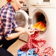 Housewife spotting stain on laundry — Stock Photo #38121503
