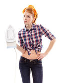 Sexy housewife holding a flat iron — Stock Photo