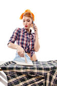 Sexy housewife talking to the phone while ironing — Stock Photo