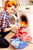 Housewife spotting a stain on the laundry — Stock Photo