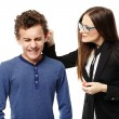 Stock Photo: Teacher grabbing student's ear