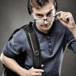 Trendy teenager looking above the glasses — Stock Photo #38302399