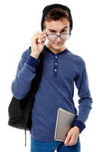 Teenager with backpack looking inquisitve above the glasses — Stock Photo