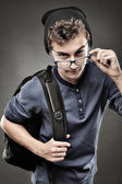 Trendy teenager looking above the glasses — Stock Photo