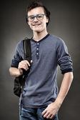 Handsome teenager with backpack and wearing glasses — Stock Photo