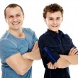 Happy father and son with arms folded — Stock Photo