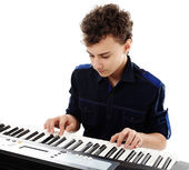 Teenager playing an electronic piano — Stock Photo