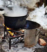 Cast-iron pot with boiling water — Stock Photo