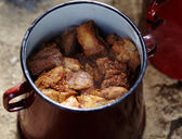 Pork chunks in a pot — Stock Photo